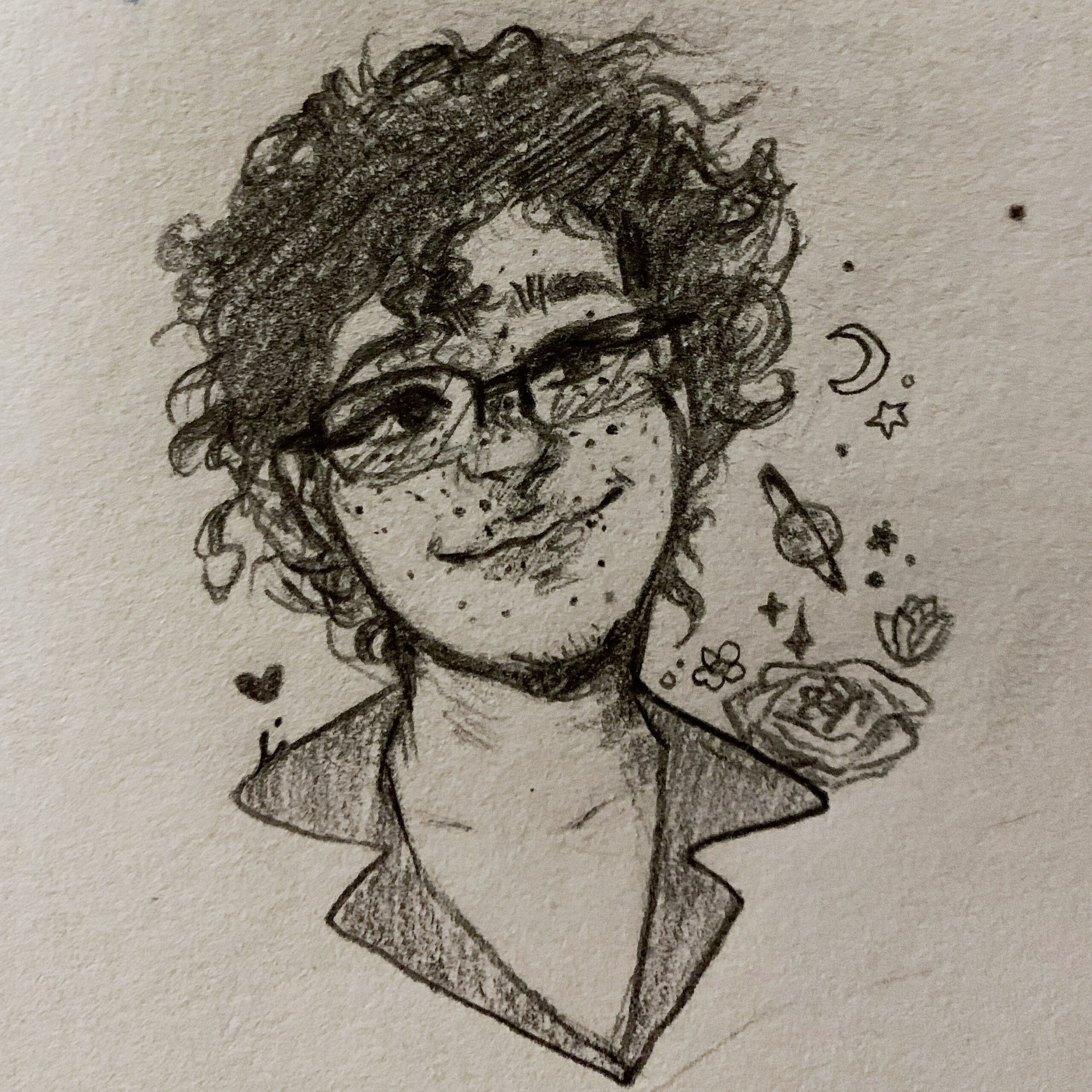 A pencil drawn image of a human with moderate-length curly hair and freckles. There are planets and stars in the background.